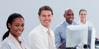 Serious business group working hard in the office Royalty Free Stock Photos