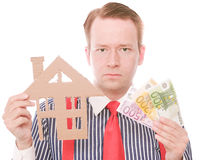 Serious business houseowner with money Royalty Free Stock Image