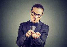 Serious business man asking for more money to pay back debt royalty free stock image