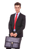 Serious business man with a briefcase Stock Photo