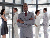 A serious business man with Business Team royalty free stock image