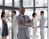 a serious business man in front of Business Team Stock Image