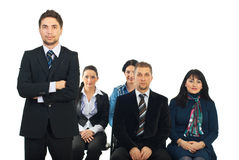 Serious business man in front of class Royalty Free Stock Images