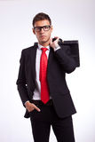 Serious business man with his briefcase on back Stock Photo