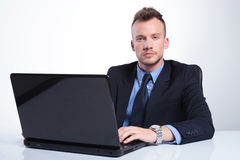 Serious business man at laptop Stock Images
