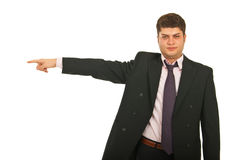Serious business man pointing Stock Photo