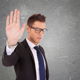 Serious business man showing stop Royalty Free Stock Image