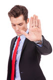 Serious business man showing stop gesture Stock Photos