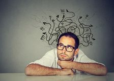 Business man thinking contemplating a solution. Serious business man thinking contemplating a solution Stock Image