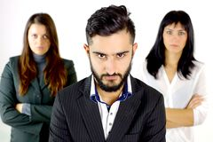 Serious business man with two women behind him Royalty Free Stock Photos