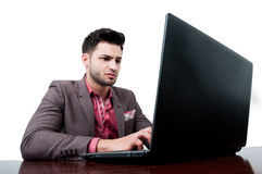 Serious business man typing on his laptop Stock Photo