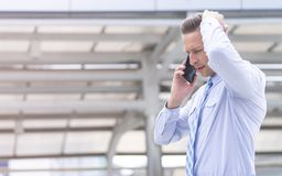 Serious Business man using mobile phone outdoor stock photography
