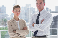 Serious business people with arms crossed Royalty Free Stock Photo