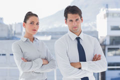 Serious business people with arms folded Royalty Free Stock Photos