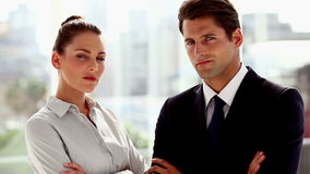 Serious business people posing together. Then smiling in the office stock footage