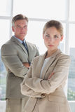 Serious business people standing with arms crossed Stock Photos