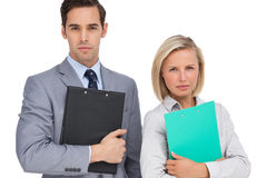 Serious business people standing together with folders Stock Photo