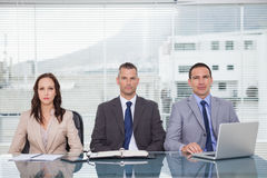 Serious business people waiting for interview Royalty Free Stock Photography