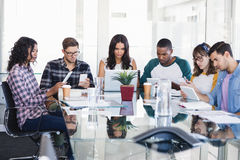 Serious business people working together at creative office. Serious business people working together at glass desk in creative office Stock Photo