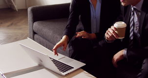 Serious business people working together while looking laptop. In office stock footage