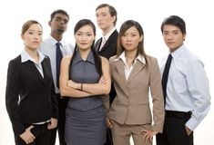 Serious Business Team. A young, dynamic and diverse group of six business people Stock Image