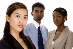 Serious Business Team. Three serious looking individuals make up a diverse business team Royalty Free Stock Images