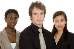 Serious Business Team. Three young business people on white background Stock Photo