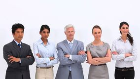 Serious business team giving the thumbsup Stock Image