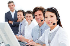 Serious business team with headset on Stock Photos
