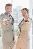 Serious business team pointing at camera Royalty Free Stock Photography