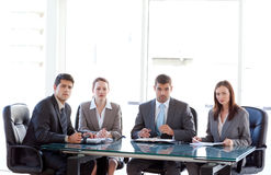 Serious business team sitting around a table Royalty Free Stock Photo