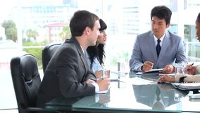 Serious business team talking together stock footage