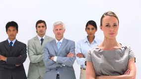 Serious business team with their arms crossed Stock Photo