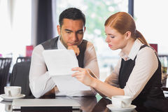 Serious business team working together in a cafe Royalty Free Stock Image
