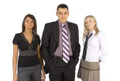 Serious Business Trio. A team of three business people, one man and two women, stand by with serious looks stock photo