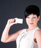 Serious business woman with blank card Stock Image