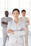 Serious Business woman with business team Stock Photo