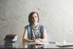 Serious business woman doing paperwork. Portrait of serious business woman or female secretary reading book or doing paperwork at desk with tools and items. Work Royalty Free Stock Photos