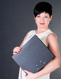 Serious business woman with file Stock Photos