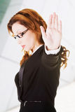 Serious business woman gesturing stop. Sign Royalty Free Stock Images