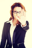 Serious business woman gesturing stop sign Royalty Free Stock Photography