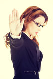 Serious business woman gesturing stop sign Stock Photos