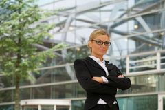 Serious business woman in glasses standing outdoors Stock Photo