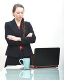 Serious business woman looking at computer Royalty Free Stock Photo