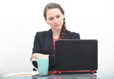Serious business woman looking at computer Stock Image