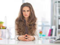 Serious business woman in modern office Stock Images