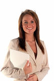 Serious business woman with paper work. Happy business woman with paper work in arms in a dress suit for office Stock Photography