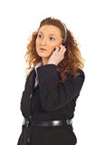 Serious business woman with phone mobile. Serious business woman thinking and talking by phone mobile looking away isolated on white background Stock Image