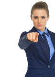 Serious business woman pointing in camera Stock Image