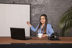 Serious business woman presenting an empty space royalty free stock photos
